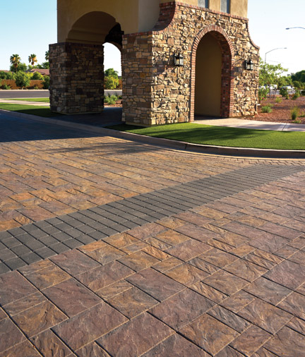 Entry atrium of yellow walled home paved with TownScape style pavers